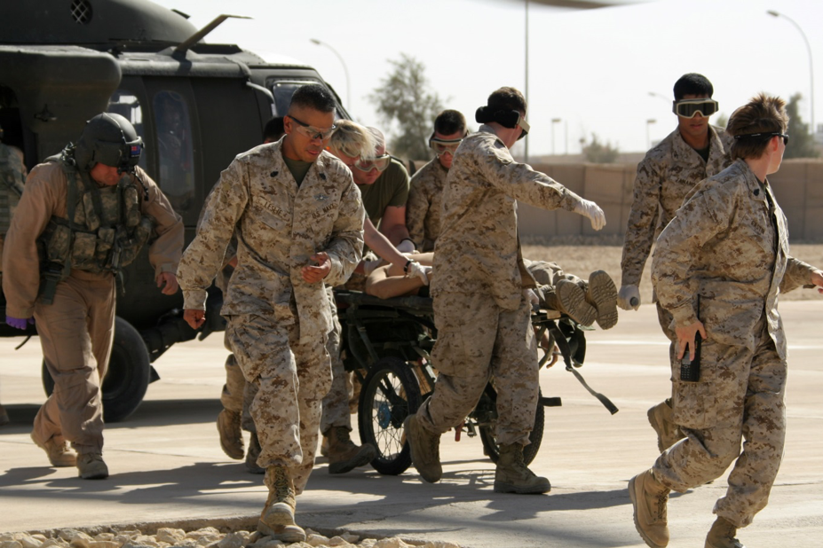 Marines and sailors rush a patient from a helicopter into the Shock Trauma Platoon area. The scene described in the story may have looked something like this. USMC photo by Cpl. James B. Hoke.